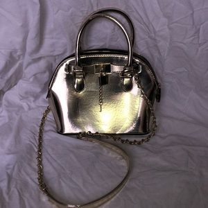 Metallic gold Aldo hand bag